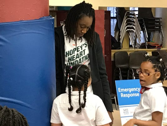 """New York Liberty forward Tina Charles talks to students at Thurgood Marshall Academy Lower School on Wednesday, April 19, 2017, in New York. Charles' foundation, Hopey's Heart, honors her aunt Maureen """"Hopey"""" Vaz, who died of multiple organ failure in 2013. It also honors Wes Leonard, a high school basketball player in Michigan who died in 2011 of sudden cardiac arrest after hitting the game-winning shot for his team. (AP Photo/Doug Feinberg)"""