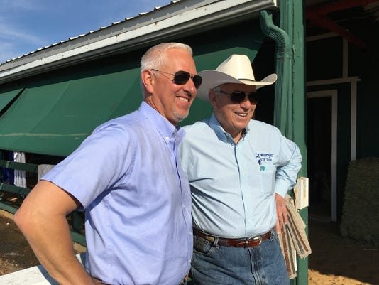 Trainers Todd Pletcher, left, and D. Wayne Lukas chat at Pimlico Race Course in Baltimore Thursday, May 18, 2017. The Preakness Stakes horse race is scheduled to take place May 20.  (AP Photo/Beth Harris)