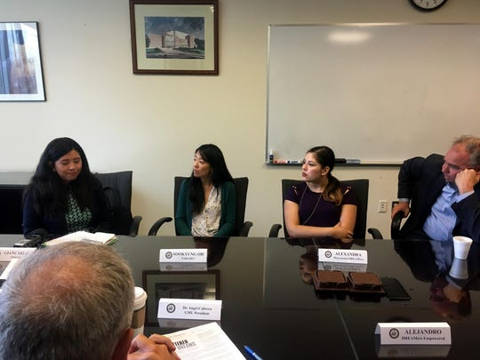 Sen. Tim Kaine, D-Va., right, listens as Giancarla Rojas, 23, left, who used to have DACA but married a U.S. citizen and now has legal status, breaks down while describing how the loss of the program would affect her sister. In 2013, Rojas and others filed a lawsuit that fought for in-state tuition at public colleges and universities for DACA students in Virginia, which allowed them to pay the lower rates the following year. MUST CREDIT: Washington Post photo by Maria Sacchetti