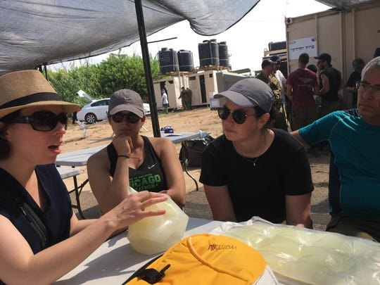 Warmilu presented the IncuBlanket at a field hospital in Israel this month. Warmilu medical director Dr. Vika Ioffe, left, answered questions about the IncuBlanket.