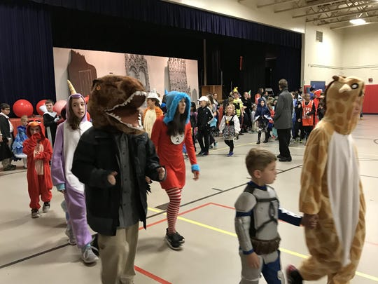 Students in the Christ the King Halloween parade.