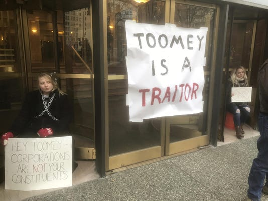 Chained To Building-Tax Bill Protest