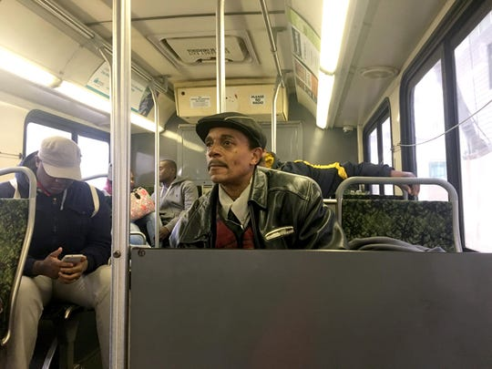 "Ray Gordon rides the westbound Michigan DDOT coach. Gordon says he keeps to himself and ignores the ""rowdy people"" he sees on the buses he rides daily."