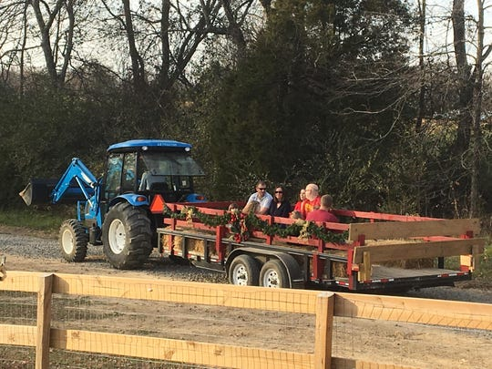 A group sets out for a Christmas Hayride at the farm.
