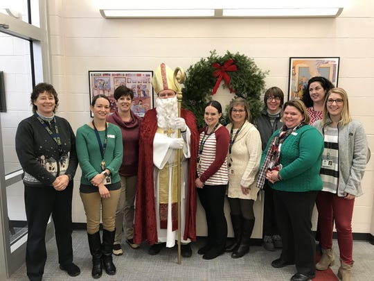 St. Nicholas posed for a picture with the teachers