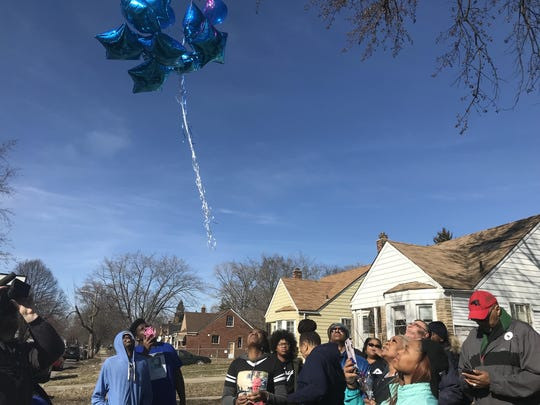 More than a dozen of friends, family and supporters gathered near the crime scene where Andre Holloway was killed. They released blue balloons in his memory.