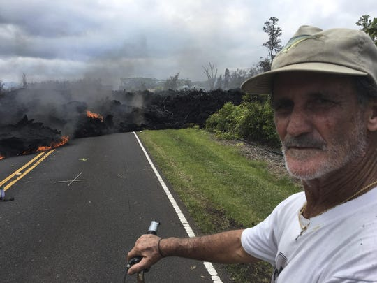 Resident Sam Knox, 65, rides his bicycle to the edge