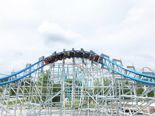 Six Flags Over Georgia in Austell, Ga., boasts the new Twisted Cyclone roller coaster, which combines a traditional wood coaster structure with a steel track.