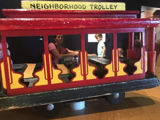 """A model of the Neighorhood Trolley at the """"How People Make Things"""" exhibit."""