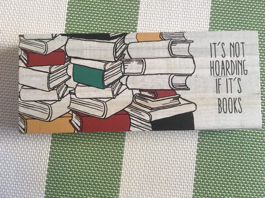 """Book lover gift: """"It's Not Hoarding If It's Books"""" plaque."""