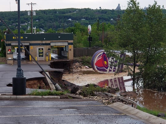 Flood damage near Razorback Drive in Houghton, MI. after a series of storms made their way through the Upper Peninsula, Sunday, June 17, 2018.