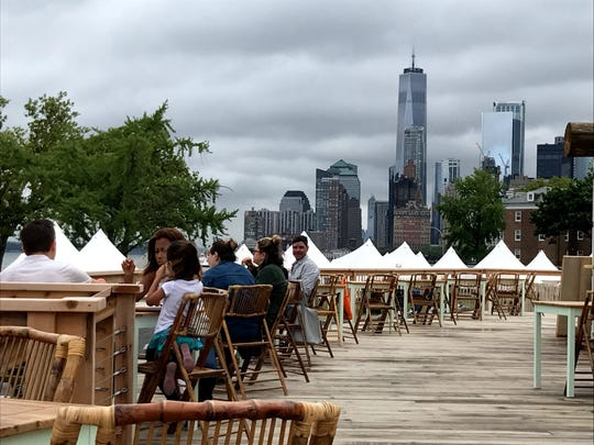 Collective Retreats on Governors Island with views of Manhattan.