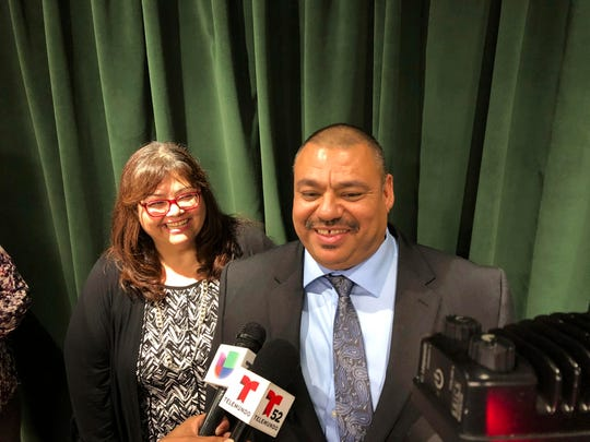 Ruben Martinez Jr., right, and his wife, Maria, talk to reporters at the Hall of Justice in downtown Los Angeles on Tuesday, when Martinez walked from Los Angeles Superior Court a free man after prosecutors reviewed his unwavering claim of innocence and agreed he had been wronged.