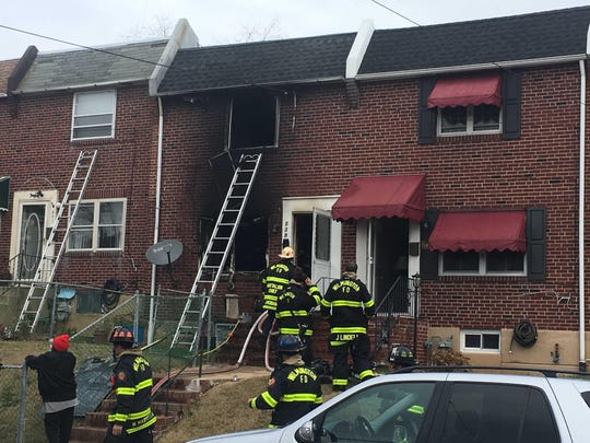 It took firefighters about 30 minutes to extinguish a blaze at a rowhouse in Wilmington, Del., in which two women were seriously injured.