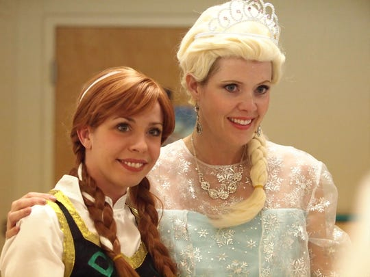 Anna (Emily Arnold) and Elsa (Beth Gobbell) came from Arendale to Aldersgate United Methodist Church for the 'Frozen Winter Carnival' Wednesday night. More than 200 children attended with their parents.
