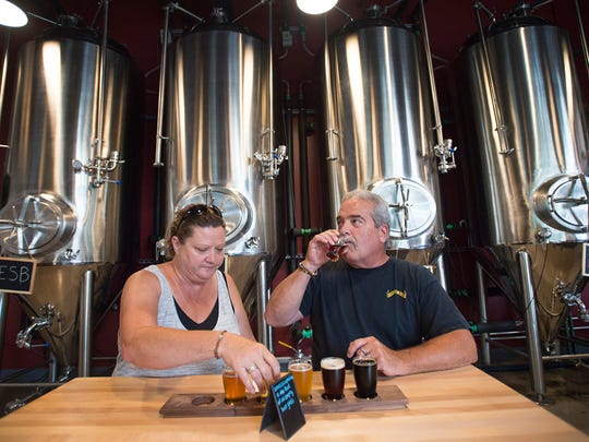 Stephanie McGovern and Jay Neighbors sample a flight of beers Friday at Maxline Brewing in Fort Collins. The brewery became the 20th brewery in Fort Collins earlier this summer.
