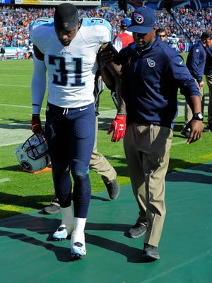 Titans strong safety Bernard Pollard is helped off the field after injuring his Achilles on Oct. 5 against the Browns.