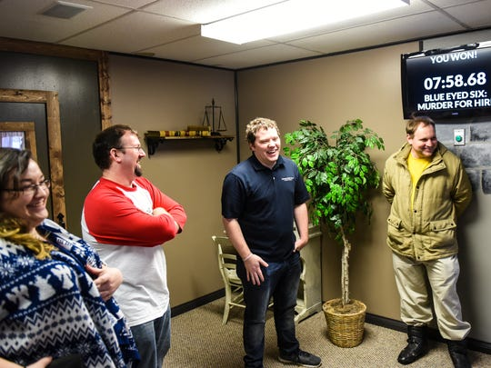 Erin Collins, community engagement team leader, Merrill Moyer, reporter, Michael Waterloo, community content editor and Daniel Walmer, reporter, laugh as members of the Lebanon Daily News staff tried to escape the Blue Eyed Six room at Escape Level 6 in Annville on Tuesday, January 26, 2016.