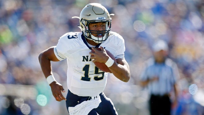 Navy Midshipmen quarterback Keenan Reynolds (19) runs the ball for a touchdown during the first half against the Air Force Falcons at Falcon Stadium.
