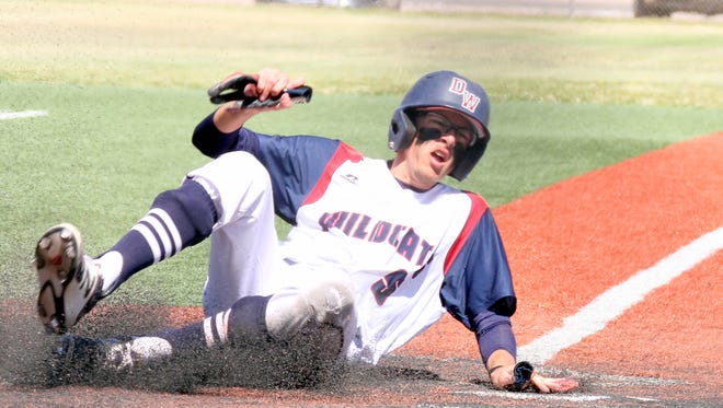 Senior John Wellington slid safely into home plate to tack on another Wildcat run during Saturday's double-header sweep over visiting Santa Teresa High at E.J. Hooten Park.