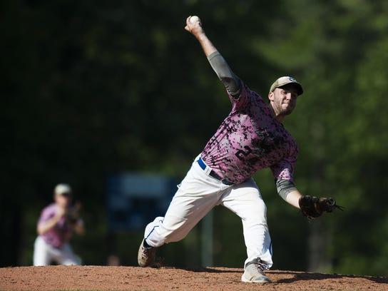 Colchester's Derek Snaderson (24) delivers a pitch