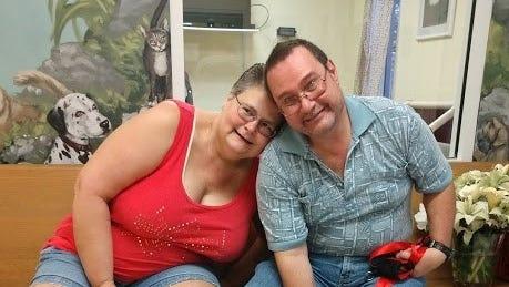 Lisa and Tim Lei take Maple home.