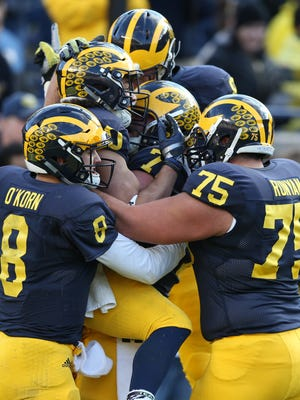 The University of Michigan Wolverines  Drake Johnson celebrates his touchdown during first half action of the Spring Game on Friday, April 1, 2016 at Michigan Stadium in Ann Arbor, Michigan.