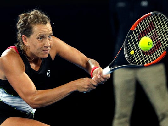 Barbora Strycova of the Czech Republic hits a backhand return to compatriot Karolina Pliskova during their fourth round match at the Australian Open tennis championships in Melbourne, Australia, Monday, Jan. 22, 2018. (AP Photo/Dita Alangkara)