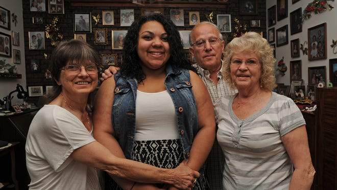 Grandmother Bonnie Sadler, left, and great-grandparents Eugene and Shirley Weyh, all of Fond du Lac, gather around Brittany Hernandez.