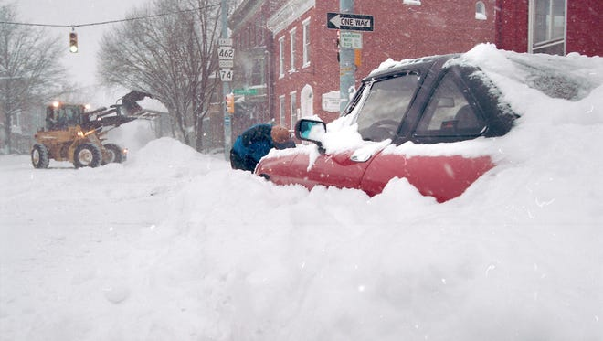 A bulldozer digs out York after a blizzard Jan. 8, 1996 dumped 30 to 36 inches of snow on the city.