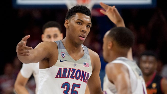 Arizona Wildcats guard Allonzo Trier (35) and guard Parker Jackson-Cartwright (0) high five during the first half against the Southern California Trojans at McKale Center, Feb. 23, 2017.