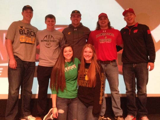 Alec Ingold, right, was among seven Bay Port High School student-athletes who signed national letters of intent on Wednesday. Front row, from left, are soccer players Kayla Tabalske and Emily Ross. Back row, from left, are football players Logan Brunette, Blair Van Ess, Cole Van Enkenvort, Troy Albrecht and Ingold.