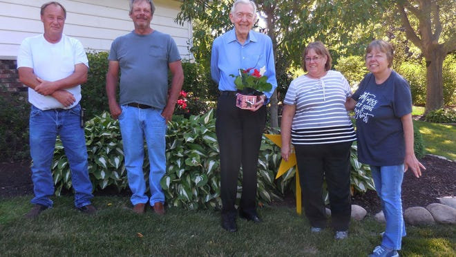 Pictured from the left are Mike Dowell and Richard Daily, who help care for the beautiful yard, Mr. Palin, and Cuba Cares representatives Alice Kuzniar and Cathy Churchill.