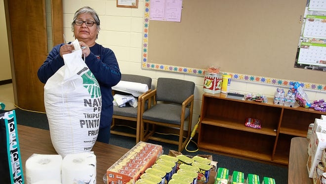 Myra Newman, division manager for the Farmington Indian Center, prepares boxes of food on Thursday for the singing groups that will be performing at a song and dance program at the center this weekend.