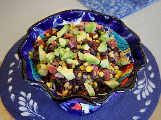 Black Bean Avocado Salsa is dressed with lime juice, olive oil and red wine vinegar.