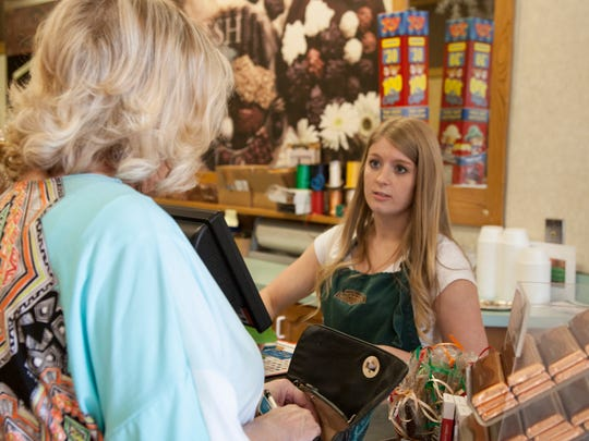 Brooke Vidal attends to a customer at the Rocky Mountain