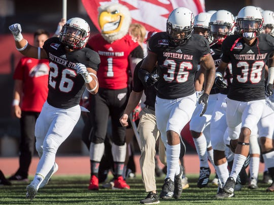The Southern Utah University football team runs onto the field for their  season opener against North Alabama University at Eccles Coliseum  Saturday, September 1, 2018.