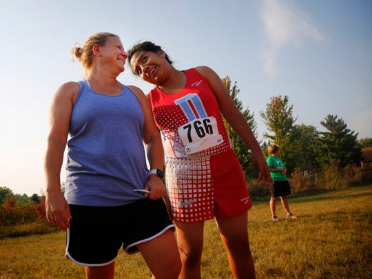 Guide runner Corrie DeMuth , left, jokes with Wendy