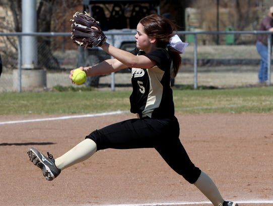 Archer City's Victoria Rater pitches against Windthorst