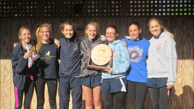 The Asheville Christian Academy girls cross country team won last year's NCISAA 2-A championship.