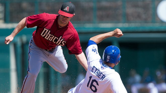 Arizona Diamondbacks infielder Aaron Hill tags out Los Angeles Dodgers outfielder Andre Ethier as he slides into second base during their spring training game at Camelback Ranch in Glendale on March 23, 2015.