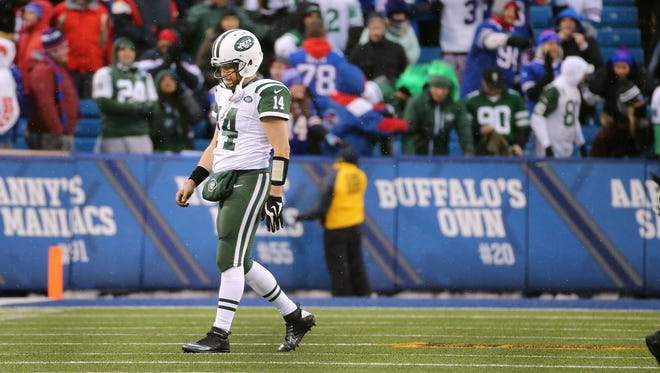 Jets quarterback Ryan Fitzpatrick had 3 interceptions in a 22-17 loss to the Bills, knocking them out of the playoffs.
