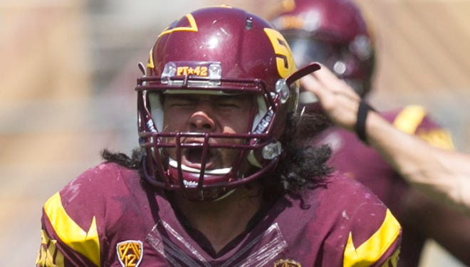 ASU linebacker Salamo Fiso reacts after batting down a pass during the ASU football spring game at Sun Devil Stadium in Tempe on Saturday, April 19, 2014.