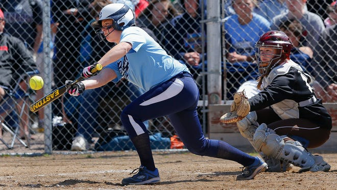 Great Falls High's Caitlyn Konesky lays down a bunt in the sixth inning against Helena Capital during the State Class AA Softball Tournament Thursday, May 29, 2014, at the Multi-Sports Complex.