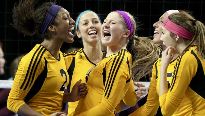 Bettendorf volleyball players celebrate a point at the state tournament last year. The Bulldogs, winners of the last two Class 5-A crowns, moved into the No. 1 spot in the rankings.