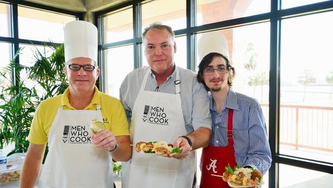 Alan Williams with his Key Lime Coconut Banana Mousse and Richard and Keller McAlpin with their Pensacola Skewers at the Men Who Cook fundraiser for the PACE Center for Girls.