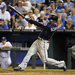 Aug 28, 2014; Kansas City, MO, USA; Minnesota Twins left fielder Jordan Schafer (1) drives in a run with a double against the Kansas City Royals in the sixth inning at Kauffman Stadium.
