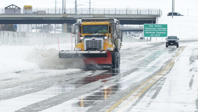 Oshkosh city streets crews were busy Monday, April 16, 2018, cleaning up after a spring storm dumped just over 11 inches of snow around the area, forcing many schools to close for the day.