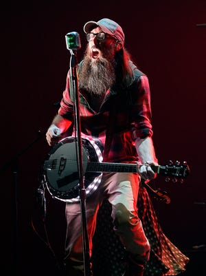 David Crowder of Crowder performs during the Dove Awards Tuesday, Oct. 13, 2015, in Nashville, Tenn. (AP Photo/Mark Zaleski)