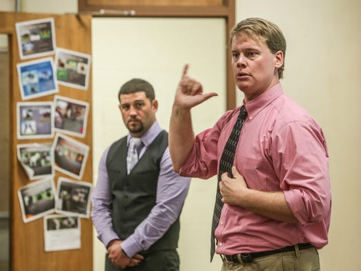 Wednesday April 24th, 2014,  Account Maintenance and Accounting Services professional, Adam Bernholtz (right), and Finance Management Analyst, Christian Hanawalt (left), from Defense Finance and Accounting Services, speak to students at the Indiana School for the Deaf's Career Day.